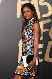 Naomie Harris paired a geometric clutch with a stamp-print dress for the 2019 Fashion for Relief London.