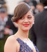 For the Met Gala, Marion Cotillard styled her hair into a unique updo with twisty bangs swept to one side.