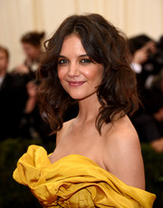 Katie Holmes looked charming with her high-volume, center-parted waves at the Met Gala.