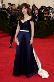 Zooey Deschanel channeled her inner fairy tale princess in a blue Tommy Hilfiger off-the-shoulder gown with a white belt and train during the Met Gala.