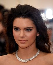 Kendall Jenner polished off her look with an opulent diamond collar necklace.
