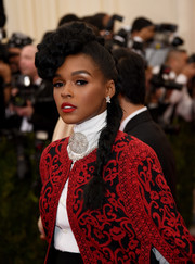 Janelle Monae styled her locks into a funky braided pompadour for the Met Gala.