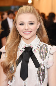 Chloe Grace Moretz kept it youthful with this flowy half-up hairstyle at the Met Gala.