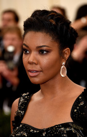 Gabrielle Union styled her hair into a French-braided updo for the Met Gala.