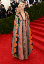 Maggie Gyllenhaal arrived for the Met Gala wearing a whimsical-print Valentino cape over a matching gown.