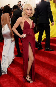 Zoe Kravitz looked super daring at the Met Gala in a red Topshop gown with a crotch-grazing slit.