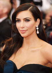 Kim Kardashian kept the glam vibe going with a pair of dangling diamond earrings by Lorraine Schwartz.