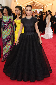 Maggie Q looked enchanting at the Met Gala in a black Zac Posen gown featuring cap sleeves and a massive sculptural skirt.
