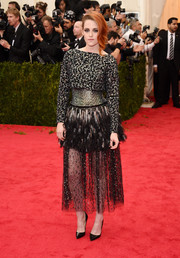 Kristen Stewart rocked sequins, feathers, and tulle all in one Chanel Couture dress during the Met Gala.