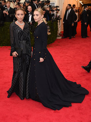 Mary-Kate Olsen stuck to a dark palette, accessorizing with a black satin clutch.