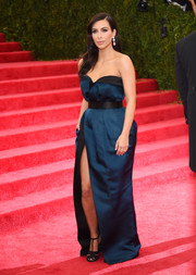 Kim Kardashian cut a shapely silhouette in a blue Lanvin strapless gown with an up-to-there slit during the Met Gala.