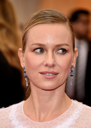 Naomi Watts went for simple elegance with this sleek side-parted bun at the Met Gala.