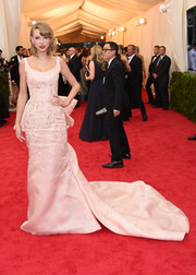 Taylor Swift looked like the sweetest princess in this embellished pink Oscar de la Renta gown featuring a cascading train during the Met Gala.