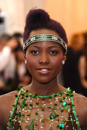 Lupita Nyong'o always loves a pop of color around the eyes, and for the Met Gala, she chose indigo which contrasted nicely with her green outfit.