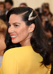 Olivia Munn adorned her hair with a beautiful wing pin for added drama.