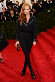 Riley Keough stood out from a sea of ballgowns in an edgy black Louis Vuitton jumpsuit during the Met Gala.