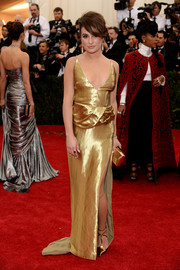 Sticking to an all-gold theme, Lea Michele paired her gown with chic T-strap pumps.