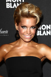 Sylvie van der Vaart showed off her gorgeous features with her hair teased into a chic pompadour style.
