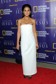 Emmanuelle Chriqui went for minimalist elegance in a sleek white strapless gown during the world premiere of 'Killing Jesus.'
