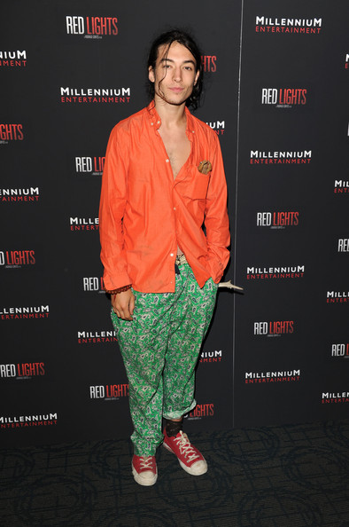 Ezra Miller completed his 'laxed' outfit with a pair of red sneakers as he posed at the 'Red Lights' New York premiere.