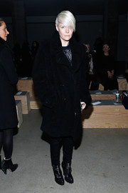Kate Lanphear went for an edgy finish with a pair of black zip-front boots.
