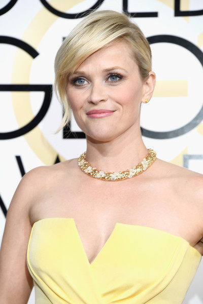 Reese Witherspoon Gold Collar Necklace [hair,hairstyle,face,blond,shoulder,eyebrow,yellow,skin,beauty,chin,arrivals,reese witherspoon,beverly hills,california,the beverly hilton hotel,golden globe awards]