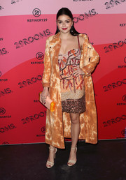 Ariel Winter added a dose of edge with an orange tie-dye coat.