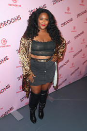For her footwear, Lizzo chose a pair of black over-the-knee boots.
