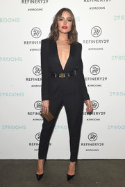 Olivia Culpo looked sharp and sultry in a deep-V black tuxedo jumpsuit during the 29Rooms event.