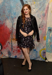 Isla Fisher layered a black leather jacket over a floral frock for the 29Rooms Los Angeles 2018.