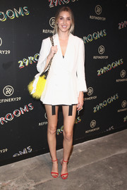 Whitney Port arrived for the 29Rooms event looking leggy in a white blazer and not much else.