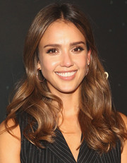 Jessica Alba left her hair loose in chic center-parted waves when she attended the 29Rooms event.