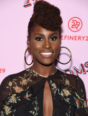 Issa Rae added more oomph with a pair of statement hoops.