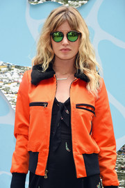 Georgia May Jagger posed for photos during the Refinery29 x Sunglass Hut Shades of You event wearing a pair of mirrored green sunnies.