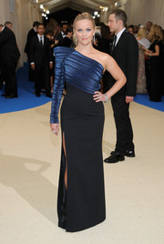 Reese Witherspoon was all about '80s power glamour in a pointy-shouldered, one-sleeve gown by Mugler at the 2017 Met Gala.
