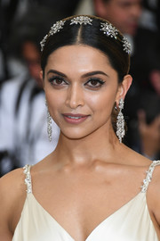 Deepika Padukone looked regal wearing this jewel-adorned chignon at the 2017 Met Gala.