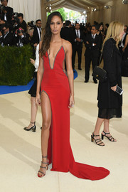 Joan Smalls was red-hot in a high-slit, plunging halter gown by Topshop at the 2017 Met Gala.
