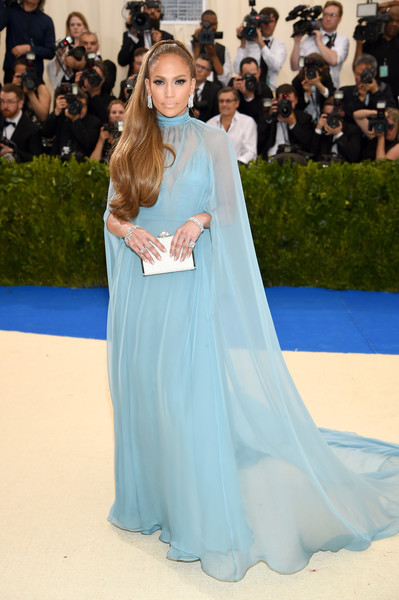 Jennifer Lopez styled her gorgeous dress with a silver box clutch by Judith Leiber.