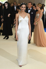 Deepika Padukone was sultry yet elegant in an ivory satin slip dress by Tommy HIlfiger at the 2017 Met Gala.