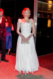 Haley Bennett attended the Met Gala after-party wearing a white corset gown rendered in layered strips of lace.