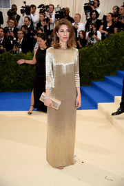 Sofia Coppola matched her gown with a gold Marc Jacobs clutch.