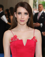 Emma Roberts opted for a loose side-parted hairstyle when she attended the 2017 Met Gala.