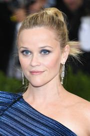 Reese Witherspoon finished off her look with Art Deco-glam diamond earrings by Tiffany & Co.