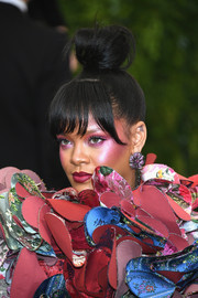 Rihanna teamed her avant-garde dress with harajuku makeup for a truly dramatic look.