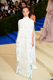 Ruth Negga attended the 2017 Met Gala looking diva-ish in a painterly-print cape gown by Valentino Couture.