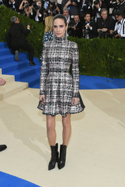 Jennifer Connelly attended the Met Gala wearing a plaid skater dress from her favorite brand, Louis Vuitton.
