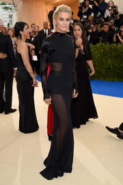 Yolanda Hadid went sultry in a black peekaboo gown by Tommy Hilfiger at the 2017 Met Gala.