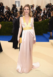 Natalia Vodianova attended the 2017 Met Gala wearing a blush and yellow satin wrap gown by Diane von Furstenberg that had an Eastern feel to it.