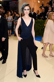 Evan Rachel Wood chose a beaded navy gown, which she toughened up with black trousers, for her 2017 Met Gala look.