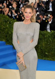 Gisele Bundchen hit the 2017 Met Gala sporting a gray box clutch and silver gown combo.